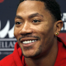 Chicago Bulls guard Derrick Rose smiles during an NBA basketball news conference about his injured knee Thursday, Dec. 5, 2013, at the United Center in Chicago The Associated Press