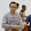 Oklahoma City Thunder coach Scott Brooks stands following a team practice in Oklahoma City, Friday, April 18, 2014. Oklahoma City will face the Memphis Grizzlies in the first round of the NBA basketball playoffs. Brooks is heading to the playoffs for the