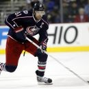 FILE - In this Feb. 21, 2012, file photo, Columbus Blue Jackets' Rick Nash skates during the second period of an NHL hockey game against the San Jose Sharks in Columbus, Ohio. The Blue Jackets finally met Nash's mid-season request and dealt him on Monday, July 23, along with a third-round pick and a minor-league defenseman to the New York Rangers for centers Brandon Dubinsky and Artem Anisimov, defenseman Tim Erixon and a first-round pick next year. (AP Photo/Terry Gilliam, File)