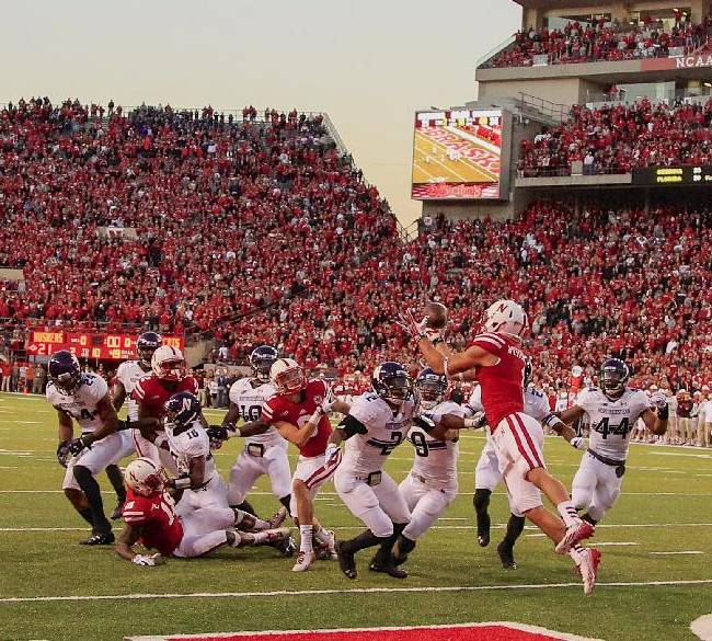 In this file image from Nov. 2, 2013, Nebraska wide receiver Jordan Westerkamp, second right, catches a tipped touchdown pass thrown by quarterback Ron Kellogg III, with no time left on the clock, for a 27-24 win in an NCAA college football game against Northwestern, in Lincoln, Neb. If Nebraska makes it back to the Big Ten championship game, the Cornhuskers might look at Westerkamp's tipped-ball touchdown on the last play against Northwestern as the one that saved their season and maybe even Bo Pelini's job