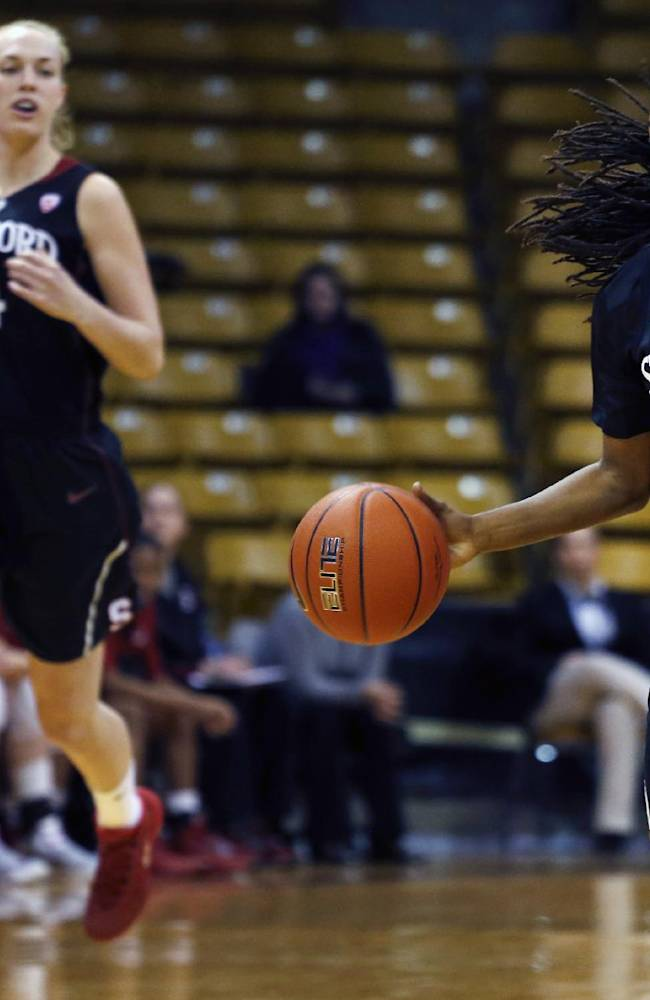 Stanford's Lili Thompson, right,  drives with the ball as teammate Taylor Greenfield looks on during an NCAA college basketball game against Colorado, in Boulder, Colo., Sunday, Jan. 12, 2014. Stanford won 87-77