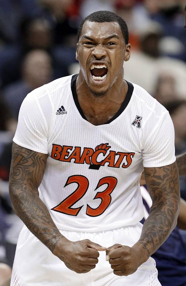 Cincinnati guard Sean Kilpatrick celebrates after scoring against Connecticut during the first half of an NCAA college basketball game in the semifinals of the American Athletic Conference tournament Friday, March 14, 2014, in Memphis, Tenn