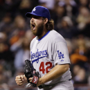 Los Angeles Dodgers reliever Chris Perez reacts as San Francisco Giants' Brandon Hicks hits into a double play to end the eighth inning of a baseball game on Tuesday, April 15, 2014, in San Francisco The Associated Press