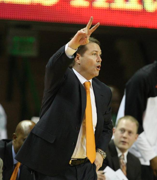 Oklahoma State head coach Travis Ford gestures from the sideline in the second half of an NCAA college basketball game against Baylor, Monday, Feb. 17, 2014, in Waco, Texas. Baylor won in overtime 70-64