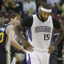 Utah Jazz forward Gordon Hayward, left, stares at Sacramento Kings center DeMarcus Cousins after Cousins bumped into him during a timeout in the third quarter of an NBA basketball game in Sacramento, Calif., Wednesday, Dec. 11, 2013. Cousins was called f