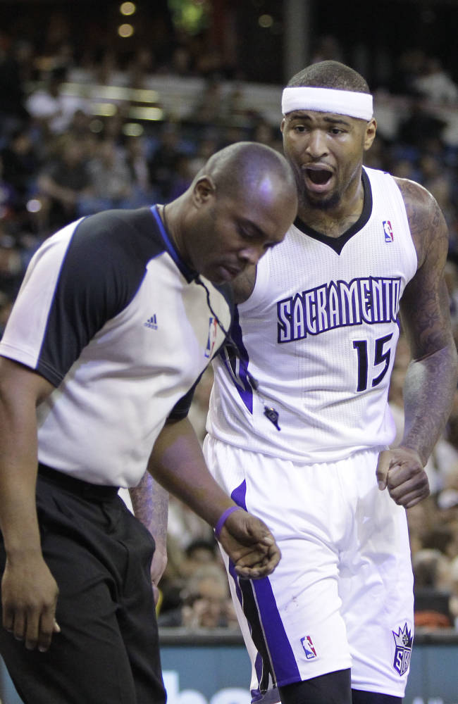 Sacramento Kings center DeMarcus Cousins questions official Courtney Kirkland after he was called for a foul during the first quarter of an NBA basketball game in Sacramento, Calif., Tuesday Feb. 25, 2014.  Cousin picked up two technical fouls and was ejected in the third quarter of the Rockets 129-103 win over the Kings