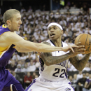 Sacramento Kings guard Isaiah Thomas, right, tries to protect the ball from Los Angeles Lakers guard Steve Blake during the fourth quarter of an NBA basketball game in Sacramento, Calif., Friday, Dec. 6, 2013. The Lakers won 106-100 The Associated Pres