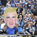San Diego Chargers fans hold an altered image of New York Giants quarterback Eli Manning during an NFL football game on Sunday, Dec. 8, 2013, in San Diego The Associated Press