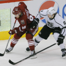 Arizona Coyotes left wing Mikkel Boedker (89) and Los Angeles Kings defenseman Drew Doughty (8) battle for the puck in the third period during an NHL hockey game, Thursday, Dec. 4, 2014, in Glendale, Ariz The Associated Press