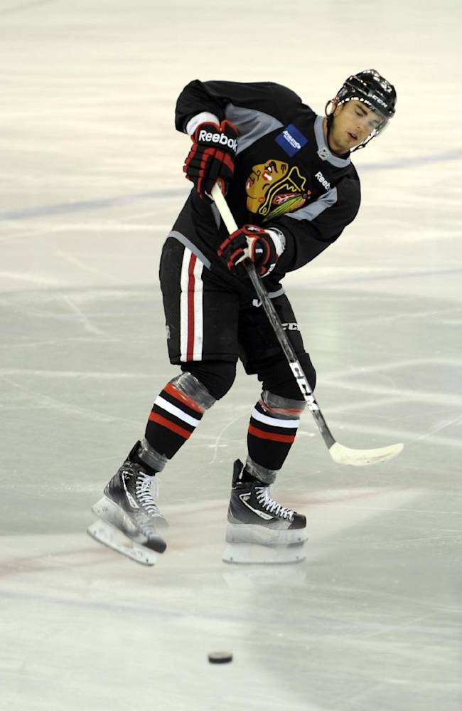 Chicago Blackhawks' Brandon Pirri passes during a practice at the teams NHL hockey training camp on the campus of the University of Notre Dame in South Bend, Ind., Thursday, Sept. 12, 2013