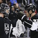 Los Angeles Kings goalie Ben Scrivens, left, and Tyler Toffoli celebrate their win against the St. Louis Blues during an NHL hockey game in Los Angeles, Monday, Dec. 2, 2013 The Associated Press