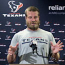 Houston Texans quarterback Ryan Fitzpatrick answers a question after reporting for NFL football training camp Friday, July 25, 2014, in Houston. The Texans begin practices Saturday The Associated Press
