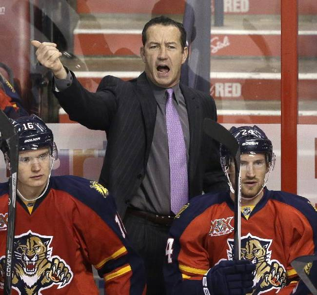 In this Oct. 13, 2013 file photo, Florida Panthers head coach Kevin Dineen calls out to players during the first period of an NHL hockey game against the Los Angeles Kings, in Sunrise, Fla. Looking on are center Aleksander Barkov (16) of Finland, and center  Brad Boyes (24). Dineen has been fired as coach of the Panthers. The team made the announcement Friday, Nov. 8, 2013, one day after their losing streak reached seven with a 4-1 loss at Boston. Also fired were assistants Gord Murphy and Craig Ramsay. Peter Horachek is the Panthers' interim head coach