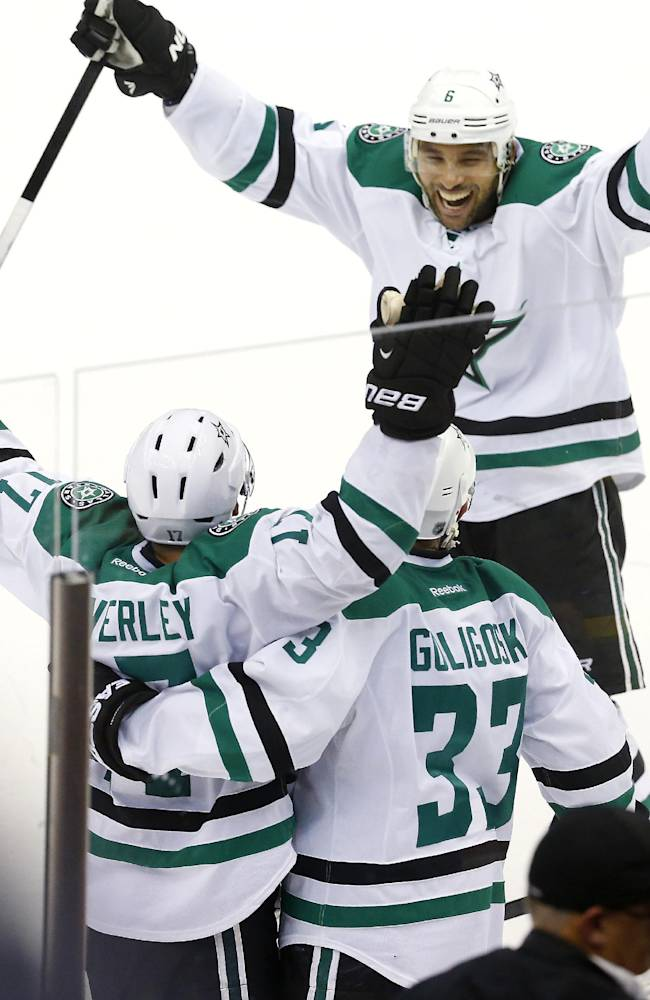 Dallas Stars center Rich Peverley (17) celebrates his game winning goal against the Detroit Red Wings with Alex Goligoski (33) and Trevor Daley (6) in the third period overtime of an NHL hockey game in Detroit Thursday, Nov. 7, 2013. Dallas won 4-3