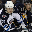 Winnipeg Jets right winger Michael Frolik (67), of the Czech Republic, checks Buffalo Sabres Nikita Zadorov (51), of Russia, during the second period of an NHL hockey game Wednesday, Nov. 26, 2014, in Buffalo, N.Y. Winnipeg won 2-1 The Associated Press