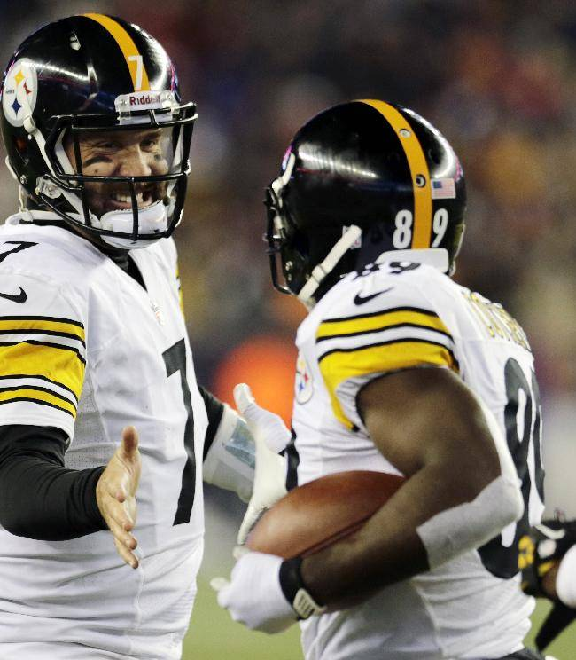 Pittsburgh Steelers quarterback Ben Roethlisberger (7) celebrates his touchdown pass to Jerricho Cotchery, center, in the third quarter of an NFL football game against the New England Patriots, Sunday, Nov. 3, 2013, in Foxborough, Mass