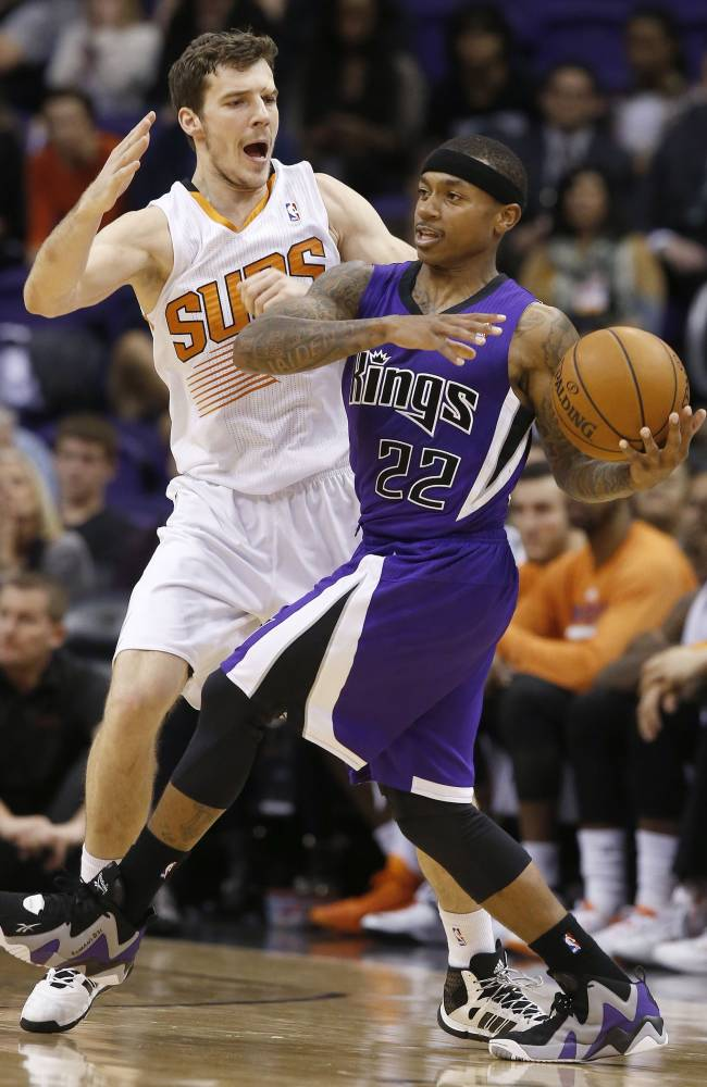 Sacramento Kings' Isaiah Thomas (22) collides with Phoenix Suns' Goran Dragic, of Slovenia, during the second half of an NBA basketball game Wednesday, Nov. 20, 2013, in Phoenix.  The Kings defeated the Suns 113-106