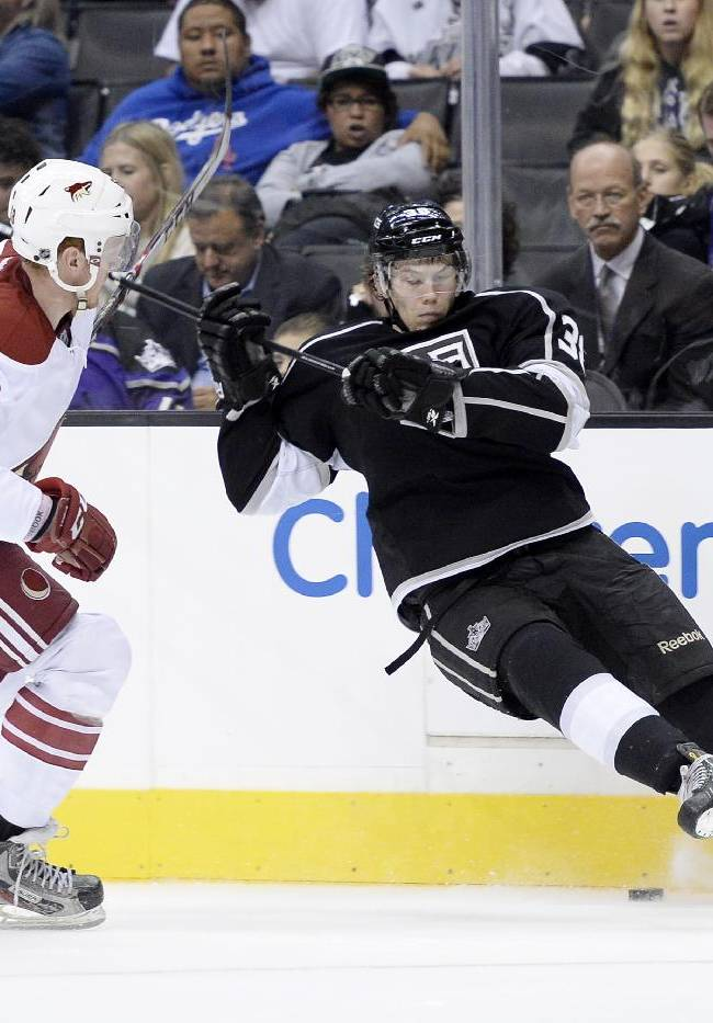 Los Angeles Kings Valentine Zykov, right, attempts to control the puck against Phoenix Coyotes James Melindy during the second period of an NHL hockey game at the Staples Center Sunday, April 15, 2013., in Los Angeles