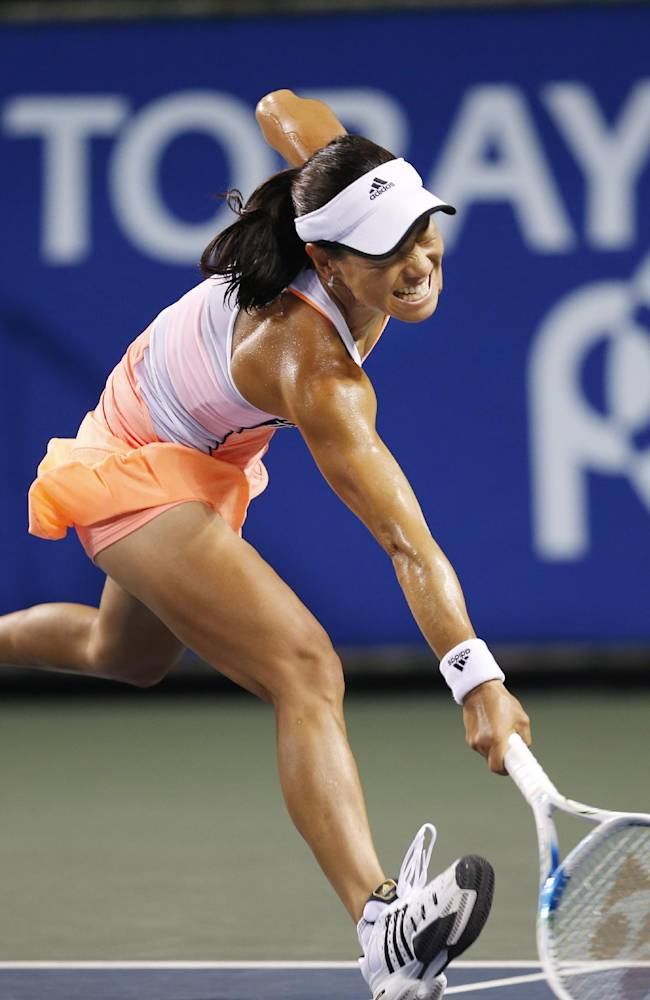 Japan's Kimiko Date-Krumm tries to returns a sot against Australia's Samantha Stosur during their second round match of the Pan Pacific Open Tennis tournament in Tokyo, Tuesday, Sept. 24, 2013