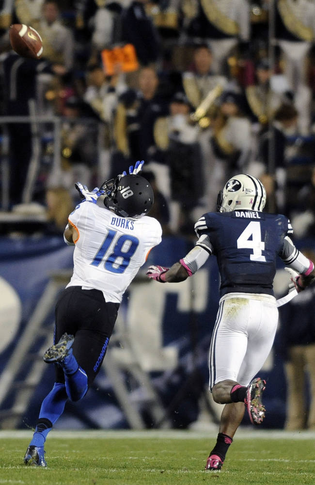 Brigham Young Cougars tight end Richard Wilson (18) hauls in a reception in front of Brigham Young Cougars defensive back Robertson Daniel (4) during a game at Lavell Edwards Stadium on Friday, Oct. 25, 2013, in Provo, Utah