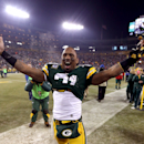 GREEN BAY, WI - JANUARY 05:  Safety Charles Woodson #21 of the Green Bay Packers celebrates after the Packers 24-10 victory against the Minnesota Vikings in the NFC Wild Card Playoff game at Lambeau Field on January 5, 2013 in Green Bay, Wisconsin.  (Photo by Andy Lyons/Getty Images)