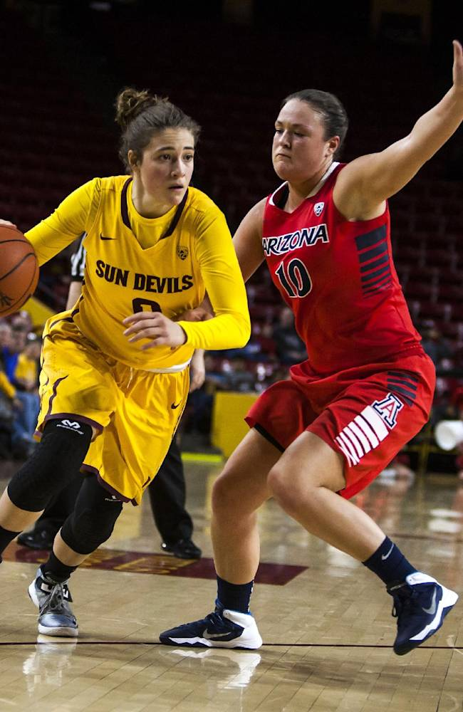 Arizona State guard Katie Hempen, left, attempts to break away from Arizona's Kama Griffitts during an NCAA college basketball game, Tuesday, Feb. 4, 2014, in Tempe, Ariz