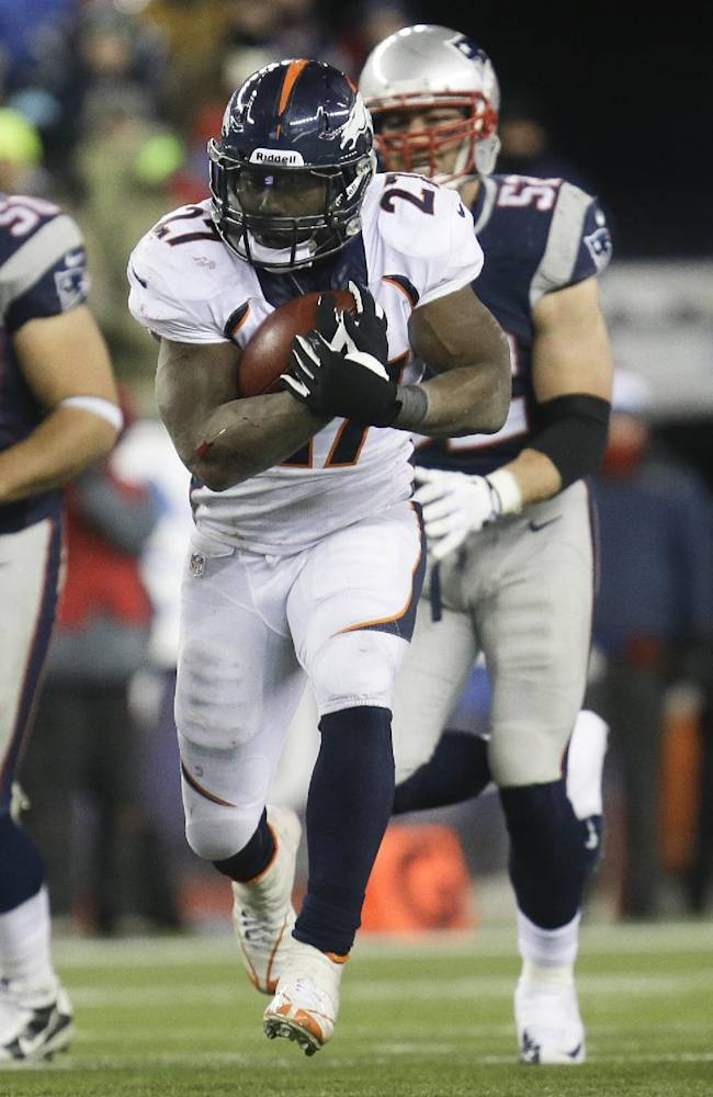 Denver Broncos running back Knowshon Moreno runs against the New England Patriots during overtime of an NFL football game Sunday, Nov. 24, 2013, in Foxborough, Mass. The Patriots won 34-31 in overtime