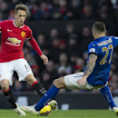 Manchester United's Adnan Januzaj, left, fights for the ball against Leicester's Marcin Wasilewski during the English Premier League soccer match between Manchester United and Leicester at Old Trafford Stadium, Manchester, England, Saturday Jan. 31, 2015