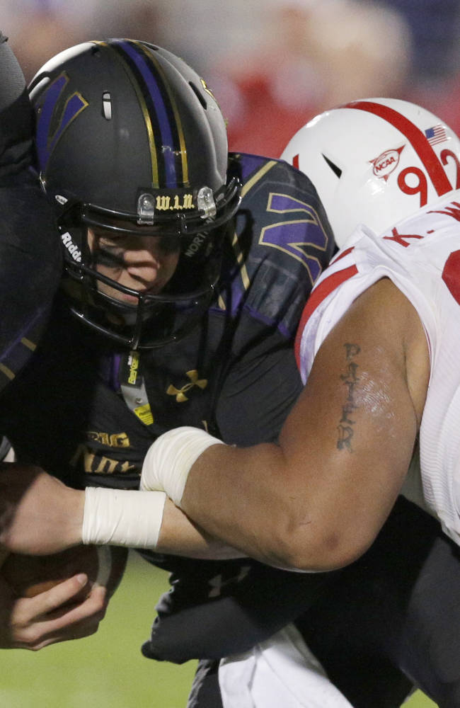 Northwestern quarterback Trevor Siemian is sacked by Nebraska defensive tackle Kevin Williams (92) during the second half of an NCAA college football game in Evanston, Ill., Saturday, Oct. 18, 2014. Nebraska won 38-17