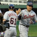 Detroit Tigers' Miguel Cabrera (24) slaps the hand of third base coach Tom Brookens (61) on the way to the plate, after hitting a three-run homer during the third inning of a baseball game against the Texas Rangers, Sunday, May 19, 2013, in Arlington, Texas. (AP Photo/John F. Rhodes)