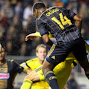 Philadelphia Union defender Amobi Okugo (14) heads the ball over Columbus Crew defender Tyson Wahl during second-half MLS soccer game action in Chester Pa., Saturday Oct. 11, 2014 The Associated Press