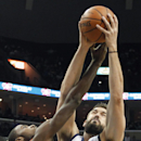 Memphis Grizzlies center Marc Gasol (33), of Spain, fights for a rebound against Charlotte Bobcats forward Michael Kidd-Gilchrist (14) in the first half of an NBA basketball game Saturday, March 8, 2014, in Memphis, Tenn The Associated Press