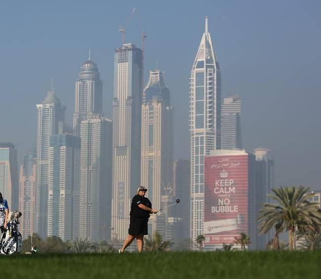 Laura Davis of England follows her ball on the 13th hole during the 1st round of the Dubai Ladies Masters golf tournament in Dubai, United Arab Emirates, Wednesday, Dec. 4, 2013