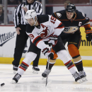 Anaheim Ducks' Ryan Getzlaf (15) and New Jersey Devils' Travis Zajac (19) vie for the puck during the first period of an NHL hockey game, Friday, Jan. 16, 2015, in Anaheim, Calif The Associated Press