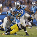 Carolina Panthers' Jonathan Stewart (28) is tackled by Pittsburgh Steelers' Mike Mitchell (23) during the second half of an NFL football game in Charlotte, N.C., Sunday, Sept. 21, 2014. (AP Photo/Bob Leverone)