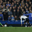 Chelsea's Demba Ba, second right, scores against Tottenham Hotspur during their English Premier League soccer match at Stamford Bridge, London, Saturday, March 8, 2014