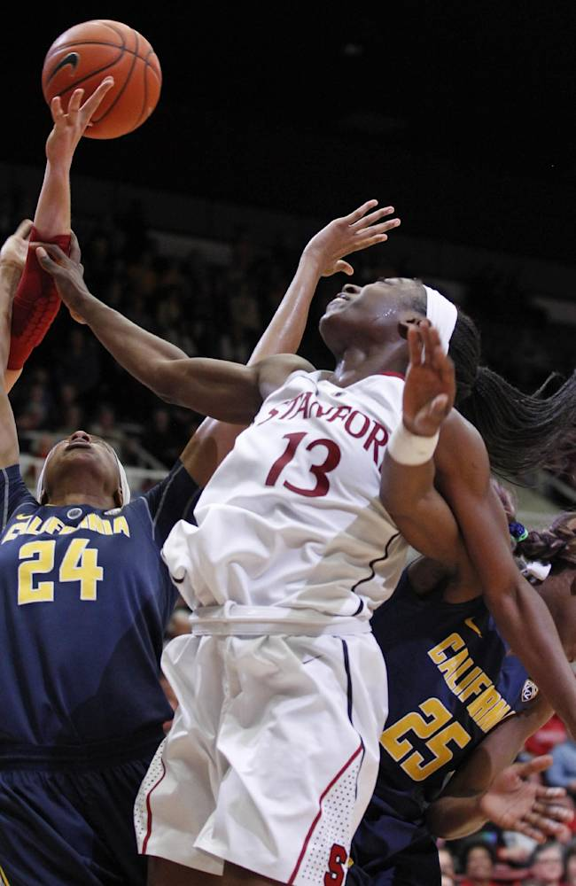 California's Courtney Range (24), Stanford's Mikaela Ruef, left, and Chiney Ogwumike (13) reach for a loose ball during the second half of an NCAA college basketball game, Thursday, Jan. 30, 2014 in Berkeley, Calif. California's Gennifer Brandon (25) is at right