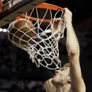 San Antonio Spurs' Tiago Splitter (22), of Brazil, dunks against the Miami Heat during the first half of Game 3 in their NBA Finals basketball series, Tuesday, June 11, 2013, in San Antonio. (AP Photo/Eric Gay)