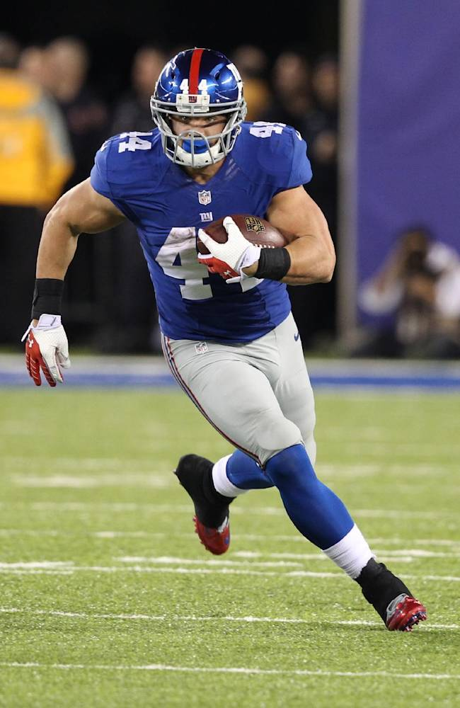 New York Giants' Peyton Hillis (44) rushes during the second half of an NFL football game against the Minnesota Vikings Monday, Oct. 21, 2013 in East Rutherford, N.J