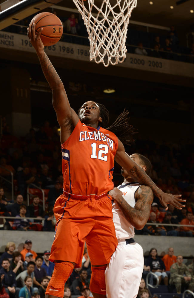 Clemson's Rod Hall (12) lays in a basket around Auburn's Allen Payne in the first half of an NCAA college basketball game on Thursday, Dec. 19, 2013, in Auburn, Ala