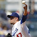 Los Angeles Dodgers pitcher Paul Maholm delivers against the San Francisco Giants in the second inning of a baseball game on Saturday, April 5, 2014, in Los Angeles The Associated Press
