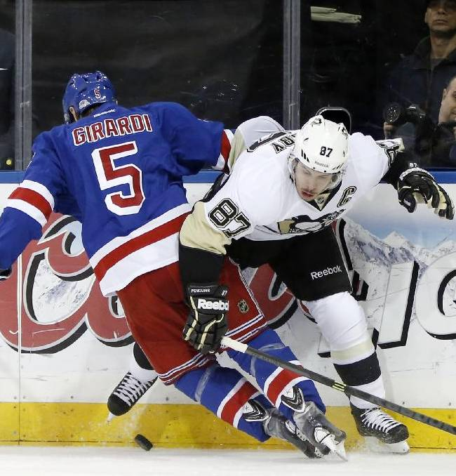 New York Rangers defenseman Dan Girardi (5) checks Pittsburgh Penguins center Sidney Crosby (87) in the first period of Game 6 of a second-round NHL playoff hockey series on Sunday, May 11, 2014, in New York