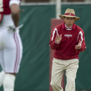 Alabama head coach Nick Saban cheers his defensive backs as they work through drills during NCAA college football practice, Saturday, March 28, 2015, in Tuscaloosa, Ala. (AP Photo/AL.com, Vasha Hunt)