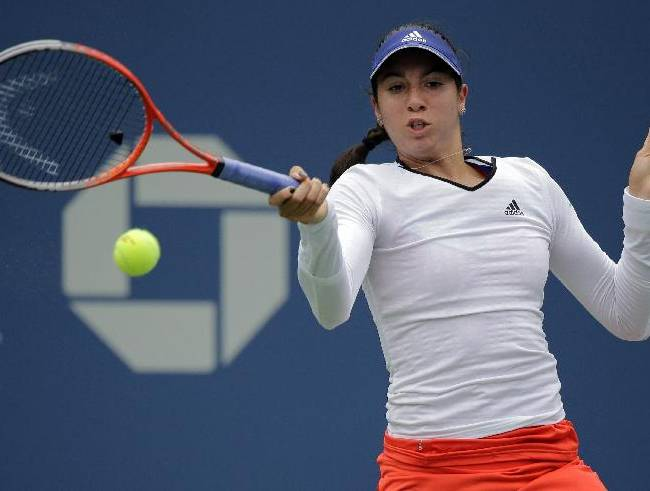 Christina McHale returns a shot against Ana Ivanovic, of Serbia, during the third round of the 2013 U.S. Open tennis tournament, Saturday, Aug. 31, 2013, in New York