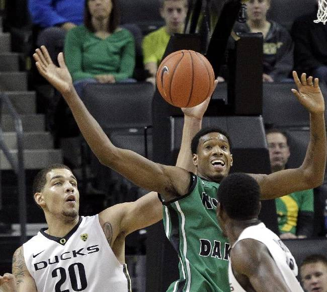 North Dakota forward Jaron Nash, back right, and Oregon center Waverly Austin (20) battle for a rebound during the first half of an NCAA college basketball game in Eugene, Ore., Saturday, Nov. 30, 2013
