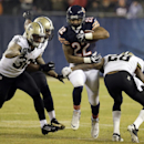 Chicago Bears running back Matt Forte (22) carries the ball against New Orleans Saints defense during the first half of an NFL football game Monday, Dec. 15, 2014, in Chicago The Associated Press