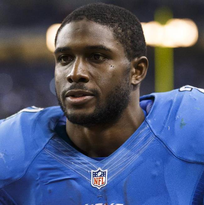 Detroit Lions running back Reggie Bush (21) on the sideline against the Green Bay Packers during an NFL football game at Ford Field in Detroit, Thursday, Nov. 28, 2013