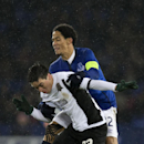 Everton's Steven Pienaar, right, fights for the ball against FC Krasnodar's Mauricio Pereyra during the Europa League Group H soccer match between Everton and FC Krasnodar at Goodison Park Stadium, Liverpool, England, Thursday Dec. 11, 2014