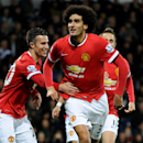 Manchester United's Marouane Fellaini celebrates after scoring against West Bromich Albion during the English Premier League soccer match between West Bromwich Albion and Manchester United at the Hawthorns, Birmingham, England, Monday, Oct. 20, 2014