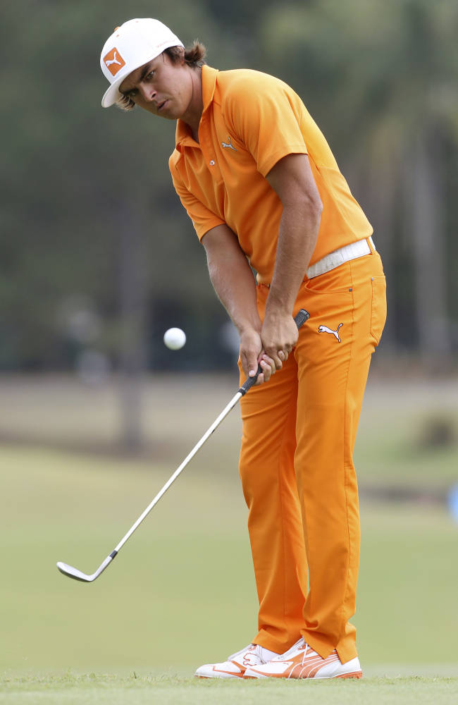 Rickie Fowler of the United States chips on the 10th green during the final round of the Australian PGA golf championship held at the Royal Pines Resort, on the Gold Coast, in Australia, Sunday, Nov. 10, 2013